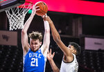 Wake Forest forward Ody Oguama (33) fouls Duke forward Matthew Hurt (21) on a rebound attempt during an NCAA college basketball game Wednesday, Feb. 17, 2021, in Wintson-Salem, N.C. (Andrew Dye/The Winston-Salem Journal via AP, Pool)