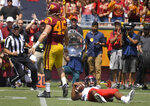 UNLV quarterback Armani Rogers, right, lies on the ground after being sacked by Southern California linebacker Porter Gustin, left, during the first half of an NCAA college football game Saturday, Sept. 1, 2018, in Los Angeles. (AP Photo/Mark J. Terrill)