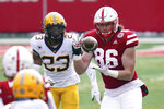 Nebraska tight end Jack Stoll (86) makes a catch in front of Minnesota defensive back Jordan Howden (23) during the first half of an NCAA college football game in Lincoln, Neb., Saturday, Dec. 12, 2020. (AP Photo/Nati Harnik)