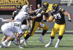 Iowa quarterback Spencer Petras (7)is tackled by Colorado State defensive lineman Scott Patchan (1) during the first quarter of an NCAA college football game, Saturday, Sept. 25, 2021, in Iowa City, Iowa. (AP Photo/Ron Johnson)