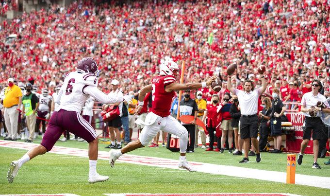 Nebraska quarterback Adrian Martinez, right, runs in a touchdown ahead of Fordham's Jesse Bramble (6) during the first half of an NCAA college football game Saturday, Sept. 4, 2021, at Memorial Stadium in Lincoln, Neb. (AP Photo/Rebecca S. Gratz)