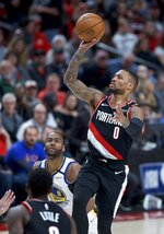 Portland Trail Blazers guard Damian Lillard, right, shoots against the Golden State Warriors during the second half of an NBA basketball game in Portland, Ore., Monday, Jan. 20, 2020. (AP Photo/Craig Mitchelldyer)