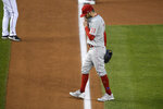 Philadelphia Phillies relief pitcher David Phelps walks toward the dugout after he was pulled during the third inning of the second baseball game of the team's doubleheader against the Washington Nationals, Tuesday, Sept. 22, 2020, in Washington. This game is a makeup from Aug. 27. (AP Photo/Nick Wass)