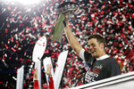 Tampa Bay Buccaneers quarterback Tom Brady (12) holds the Vince Lombardi trophy following the NFL Super Bowl 55 football game against the Kansas City Chiefs, Sunday, Feb. 7, 2021, in Tampa, Fla. Tampa Bay won 31-9. (Ben Liebenberg via AP)