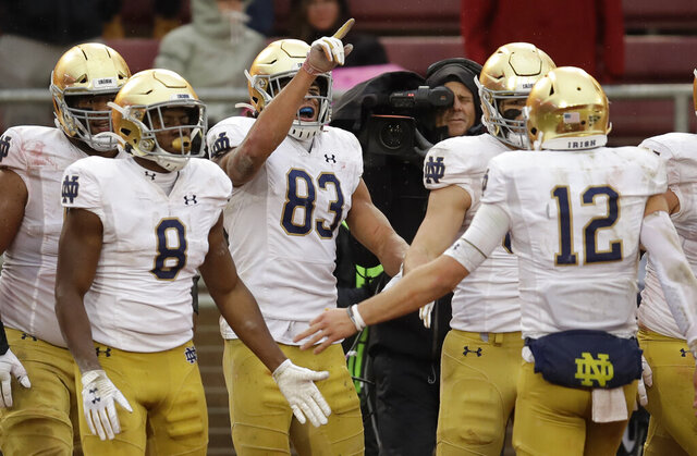 Notre Dame's Chase Claypool (83) celebrates after scoring a touchdown against Stanford in the second half of an NCAA college football game Saturday, Nov. 30, 2019, in Stanford, Calif. (AP Photo/Ben Margot)