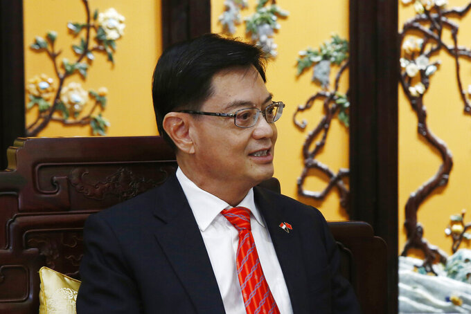 """FILE - In this Wednesday, May 22, 2019 file photo, Singapore's Deputy Prime Minister Heng Swee Keat attends a meeting with Chinese Vice Premier Han Zheng, at Diaoyutai state guesthouse in Beijing. Singapore's designated future leader, Deputy Prime Minister Heng Swee Keat, has taken himself out of the running in a surprise decision, saying in a letter released Thursday, April 8, 2021 that a younger person with a """"longer runway"""" should become the next prime minister.  (Florence Lo/Pool Photo via AP, File)"""