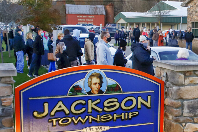 FILE - In this Nov. 3, 2020, file photo, people line up outside a polling place at the Jackson Township Municipal Building, before voting in the general election, in Jackson Township, Pa. A Republican proposal made public on Thursday, June 10, 2021, would revamp Pennsylvania election law to affect deadlines, early voting and mail-in ballots and require ID for all in-person voters. (AP Photo/Keith Srakocic, File)