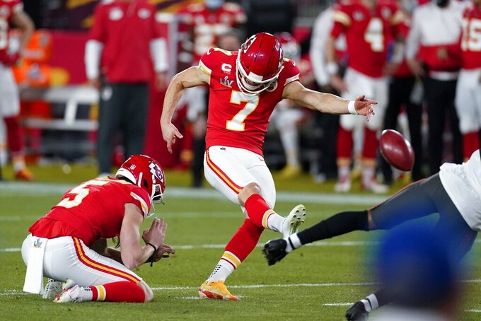 Kansas City Chiefs kicker Harrison Butker kicks a 49-yard field goal against the Tampa Bay Buccaneers during the first half of the NFL Super Bowl 55 football game, Sunday, Feb. 7, 2021, in Tampa, Fla. (AP Photo/Ashley Landis)