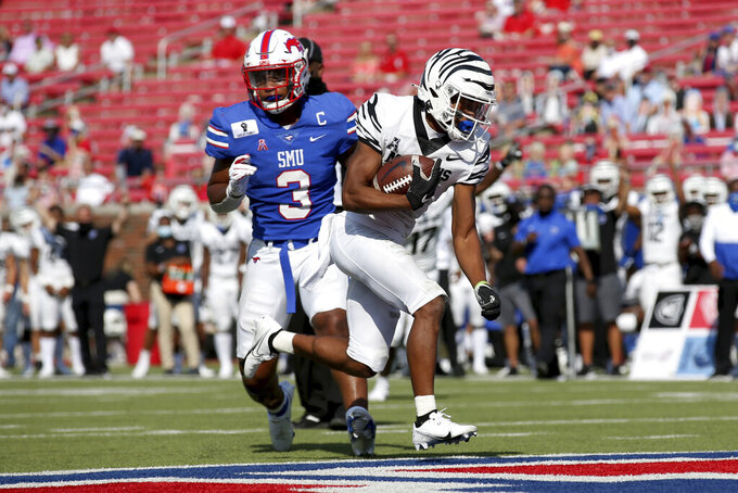 Memphis tight end Sean Dykes, right, avoids a tackle by SMU linebacker Delano Robinson (3) and scores a touchdown during the first half of an NCAA college football game in Dallas, Saturday, Oct. 3, 2020. (AP Photo/Roger Steinman)