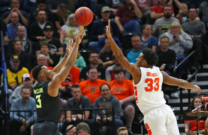 Baylor guard King McClure (3) shoots as Syracuse forward Elijah Hughes (33) defends during the first half of a first-round game in the NCAA men's college basketball tournament Thursday, March 21, 2019, in Salt Lake City. (AP Photo/Rick Bowmer)