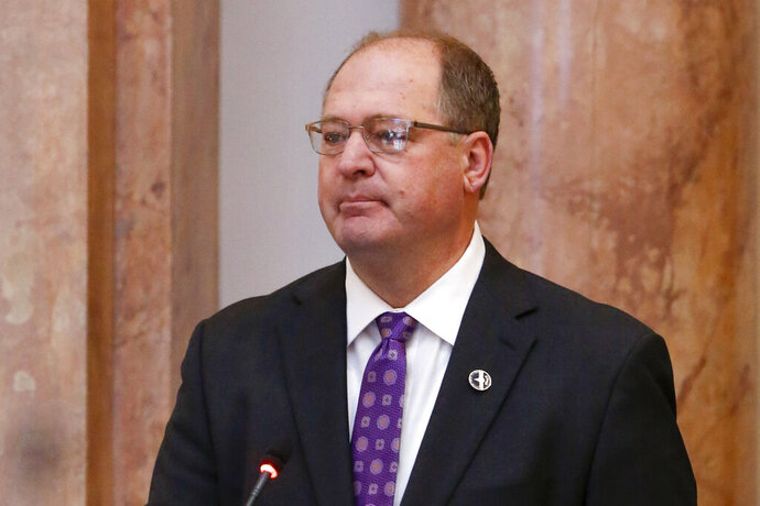FILE- In this Jan. 8, 2018, file photo, Kentucky House Speaker Jeff Hoover resigns from his role as Speaker of the House in a floor speech during the General Assembly in the State Capitol in Frankfort, Ky. Hoover says he won't run for reelection in 2020, ending a long legislative career tarnished by his involvement in a secret sexual harassment settlement. Hoover stepped down as House speaker in early 2018 after acknowledging he settled sexual harassment claims with a woman who served as a Republican staffer.  (AP Photo/Michael Reaves, File)