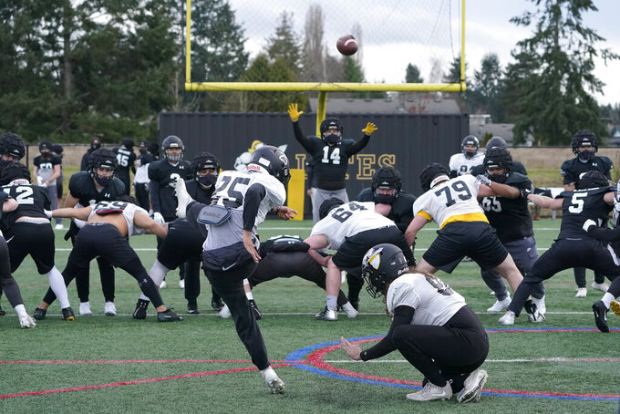 Pacific Lutheran college football players practice field goals Tuesday, Feb. 2, 2021, in Tacoma, Wash. For all the attention heaped on the FBS level of college football last fall as it tried to play, it will not be the only college football during the 2020-21 sports calendar as a handful of NCAA Division III and NAIA programs begin some form of a winter/spring season Saturday, Feb. 6. (AP Photo/Ted S. Warren)