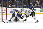 St. Louis Blues goaltender Jordan Binnington (50) makes a glove save against Los Angeles Kings' Kyle Clifford (13) during the second period of an NHL hockey game Thursday Oct. 24, 2019, in St. Louis. (AP Photo/Scott Kane)