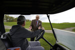 Al Lindsay, chairman of the Butler County Republican Committee, talks with a ranger who works at his family's Birdsfoot Golf Club in Freeport, Pa., on Oct. 15, 2020. Lindsay says the push to register conservative voters has been made easy by frustrations over pandemic lockdowns and a growing belief that Democrats don't understand people who are religious and rural. (AP Photo/Gene J. Puskar)