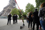 Police prevent tourists from entering the area of the Eiffel Tower Monday, May 20, 2019 in Paris. The Eiffel Tower has been closed to visitors after a person has tried to scale it. (AP Photo/Michel Euler)