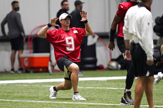 New Orleans Saints quarterback Drew Brees (9) stretches during practice at their NFL football training facility in Metairie, La., Wednesday, Sept. 2, 2020. (AP Photo/Gerald Herbert, Pool)