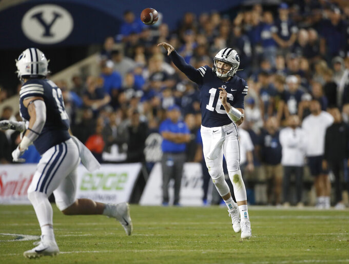 BYU quarterback Baylor Romney (16) passes the ball to BYU fullback Masen Wake (13) in the first half of an NCAA college football game against South Florida Saturday, Sept. 25, 2021, in Provo, Utah. (AP Photo/George Frey)
