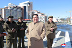 In this undated photo provided on Wednesday, Oct. 16, 2019, by the North Korean government, North Korean leader Kim Jong Un, second right, visits a construction site in Samjiyon County, North Korea. Independent journalists were not given access to cover the event depicted in this image distributed by the North Korean government. The content of this image is as provided and cannot be independently verified. Korean language watermark on image as provided by source reads: