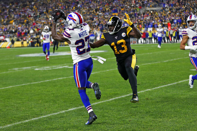 Buffalo Bills cornerback Tre'Davious White (27) intercepts a pass from Pittsburgh Steelers quarterback Devlin Hodges (not shown) intended for Steelers wide receiver James Washington (13) during the first half of an NFL football game in Pittsburgh, Sunday, Dec. 15, 2019. (AP Photo/Keith Srakocic)