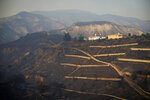 Homes sit on a ridge in the Porter Ranch area of Los Angeles after the Saddleridge Fire burned thousands of acres during Santa Ana wind conditions on Friday, Oct. 11, 2019. The wildfire is raging along the northern border of Los Angeles as powerful Santa Ana winds sweep Southern California. (Sarah Reingewirtz/The Orange County Register via AP)