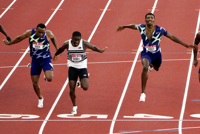FILE - In this June 20, 2021, file photo, Trayvon Bromell wins the men's 100-meter run at the U.S. Olympic Track and Field Trials in Eugene, Ore. The man positioned to take over the sprint game in the post-Usain Bolt world is Bromell. He's a 26-year-old American who is as unassuming as he is fast. (AP Photo/Chris Carlson)