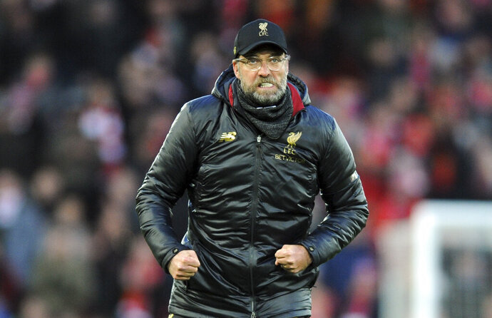 Liverpool manager Juergen Klopp greets supporters at the end of the English Premier League soccer match between Liverpool and AFC Bournemouth at Anfield stadium in Liverpool, England, Saturday, Feb. 9, 2019. (AP Photo/Rui Vieira)