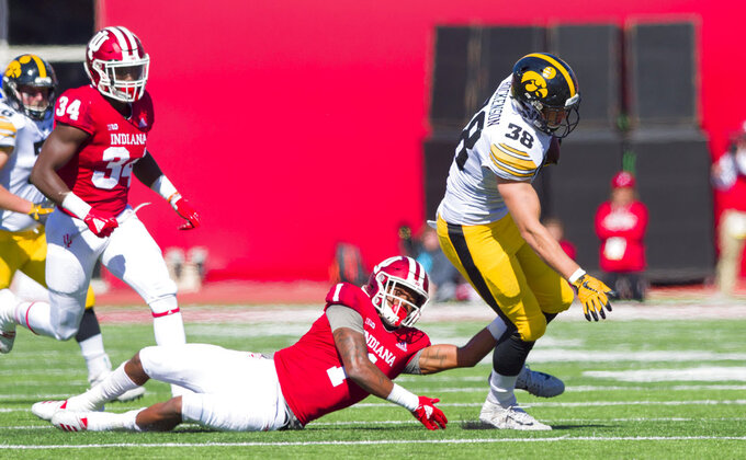 Indiana defensive back Juwan Burgess (1) tries to tackle Iowa tight end T.J. Hockenson (38) as he rushes the ball up field during the second half of an NCAA college football game Saturday, Oct. 13, 2018, in Bloomington, Ind. Iowa won 42-16. (AP Photo/Doug McSchooler)
