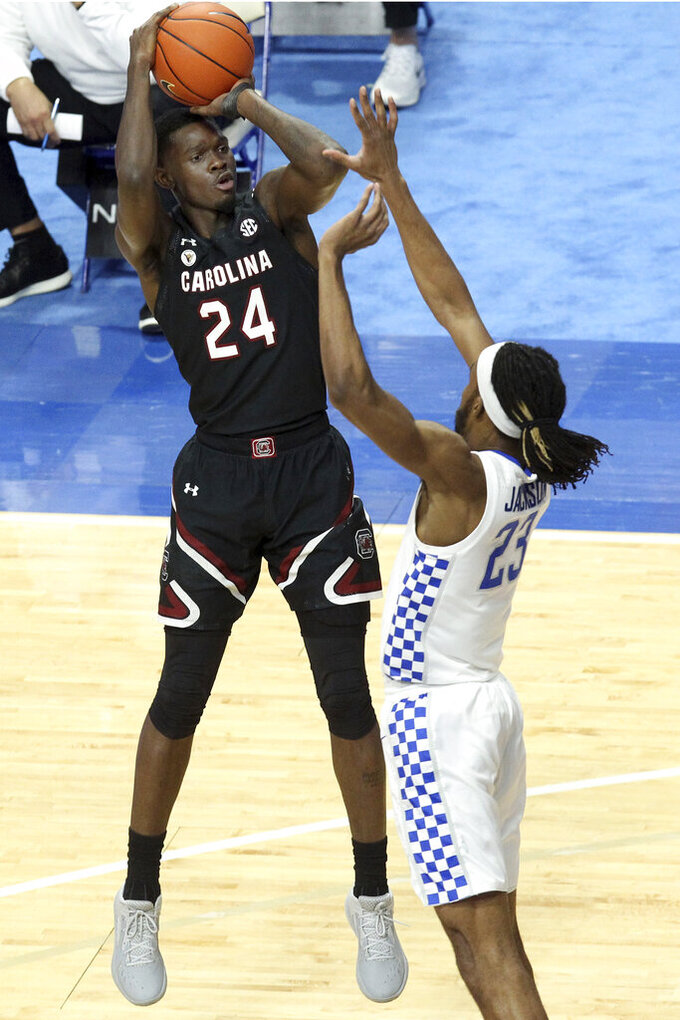 South Carolina's Keyshawn Bryant (24) shoots over Kentucky's Isaiah Jackson during the first half of an NCAA college basketball game in Lexington, Ky., Saturday, March 6, 2021. (AP Photo/James Crisp)