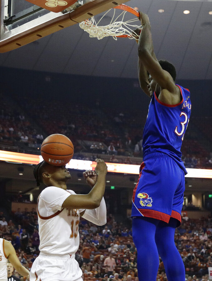 Kansas center Udoka Azubuike (35) score over Texas guard Jase Febres (13) during the first half of an NCAA college basketball game, Saturday, Jan. 18, 2020, in Austin, Texas. (AP Photo/Eric Gay)