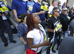 Erica Murphy, a member of Iron Workers Union 378, joins other union members and supporters of a bill to limit when companies can label workers as independent contractors, at a rally in Sacramento, Calif., Wednesday, July 10, 2019. The measure, AB5 by Assemblywoman Lorena Gonzalez, D-San Diego, aimed at major employers like Uber and Lyft, was approved by a Senate committee, Wednesday, and still needs approval by the full Senate. (AP Photo/Rich Pedroncelli)
