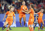 Netherlands' Lieke Martens, center, celebrates after scoring her side's second goal from the penalty spot during the Women's World Cup round of 16 soccer match between the Netherlands and Japan at the Roazhon Park, in Rennes, France, Tuesday, June 25, 2019. (AP Photo/David Vincent)