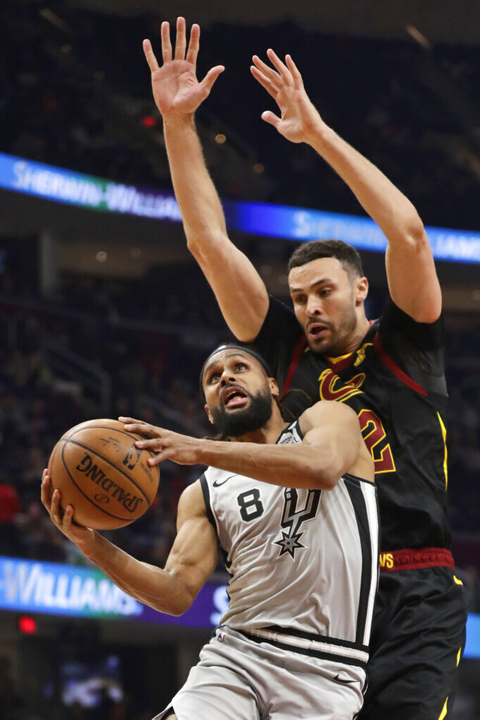San Antonio Spurs' Patty Mills (8) drives against Cleveland Cavaliers' Larry Nance Jr. (22) in the second half of an NBA basketball game, Sunday, March 8, 2020, in Cleveland. The Cavaliers won 132-129 in overtime. (AP Photo/Tony Dejak)