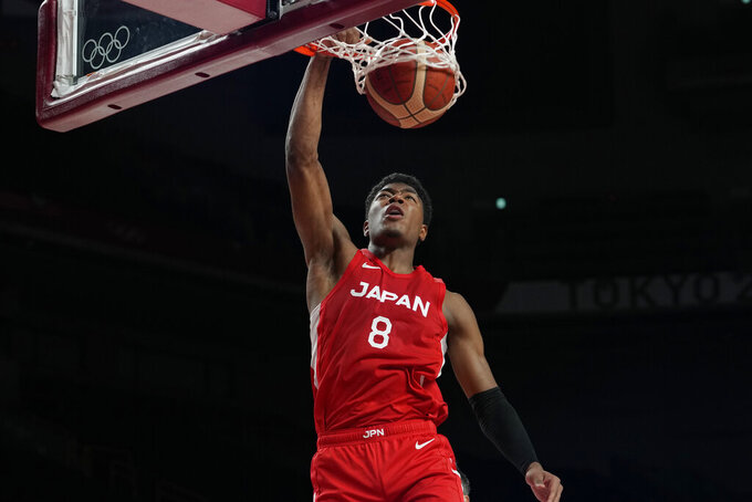 Japan's Rui Hachimura (8) scores during men's basketball preliminary round game against Argentina at the 2020 Summer Olympics, Sunday, Aug. 1, 2021, in Saitama, Japan. (AP Photo/Eric Gay)