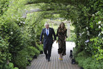 Britain's Prime Minister Boris Johnson and wife Carrie Johnson arrive for a G7 leaders reception at the Eden Project in Cornwall, England, Friday June 11, 2021, during the G7 summit. (Jack Hill/Pool via AP)