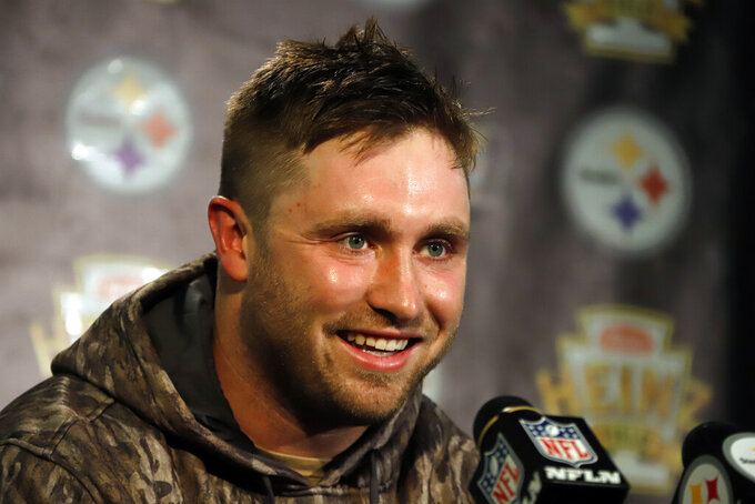 Pittsburgh Steelers quarterback Devlin Hodges meets with reporters after an NFL football game against the Cleveland Browns in Pittsburgh, Sunday, Dec. 1, 2019. (AP Photo/Gene J. Puskar)