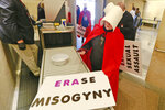 Equal Rights Amendment supporters make their way through security as they arrive for for the 2020 session outside Virginia state Capitol in Richmond, Va., Wednesday, Jan. 8, 2020. (AP Photo/Steve Helber)