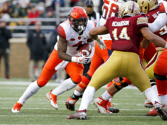 Syracuse running back Dontae Strickland (4) rushes with the ball as Boston College linebacker Max Richardson (14) defends during the second half of an NCAA college football game, Saturday, Nov. 24, 2018, in Boston. (AP Photo/Mary Schwalm)