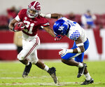 Alabama running back Jase McClellan (21) tries to fend off Kentucky defensive back Kelvin Joseph (1) during an NCAA college football game Saturday, Nov. 21, 2020, in Tuscaloosa, Ala. (Mickey Welsh/The Montgomery Advertiser via AP)