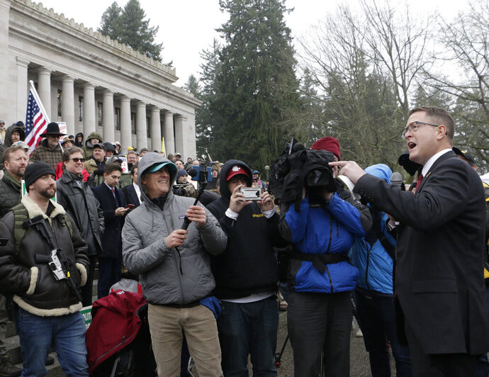 Republican Rep. Matt Shea speaks at a gun-rights rally, where many gathered in support of the embattled lawmaker, Friday, Jan. 17, 2020, in Olympia, Wash. Shea was suspended from the Republican caucus in the wake of a December report that found he was involved in anti-government activities and several lawmakers have called on him to resign, something he says he will not do. (AP Photo/Rachel La Corte)