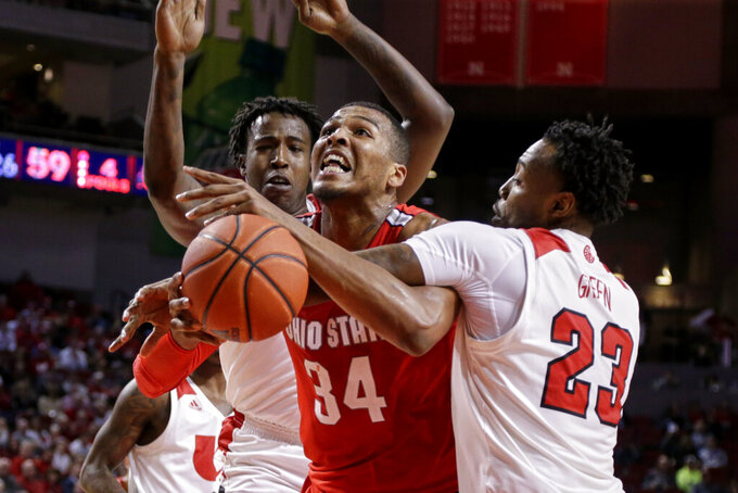 Nebraska's Jervay Green (23) fouls Ohio State's Kaleb Wesson (34) as Cam Mack defends, rear, during the second half of an NCAA college basketball game in Lincoln, Neb., Thursday, Feb. 27, 2020. (AP Photo/Nati Harnik)