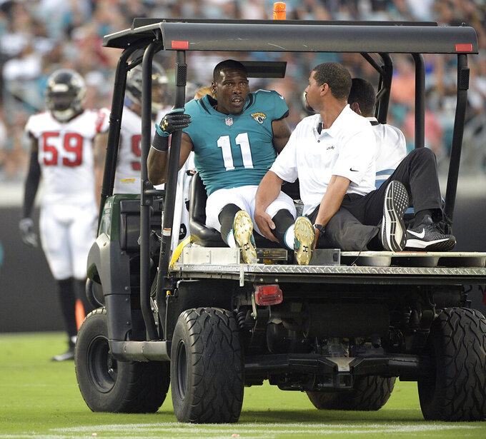 FILE - In this Aug. 25, 2018, file photo, Jacksonville Jaguars wide receiver Marqise Lee (11) leaves the field on a medical cart after he was injured during the first half of an NFL preseason football game in Jacksonville, Fla. The Jaguars waived oft-injured receiver Marqise Lee on Monday, April 20, 2020, to create nearly $5 million in salary cap space. (AP Photo/Phelan M. Ebenhack, File)