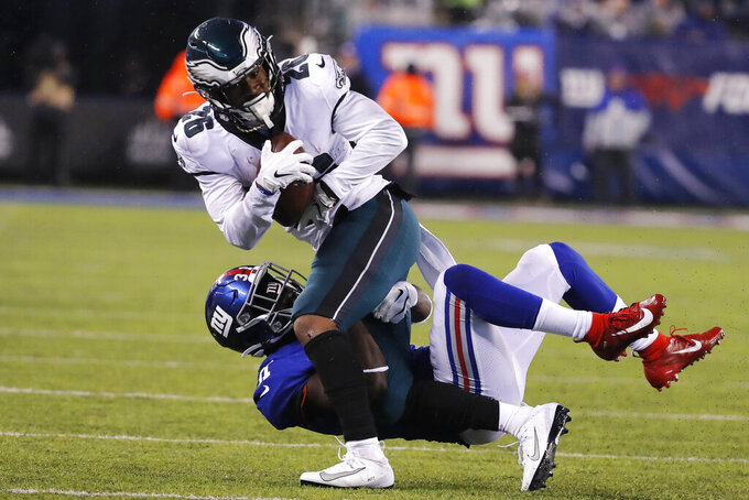 New York Giants defensive back Michael Thomas (31) stops Philadelphia Eagles running back Miles Sanders (26) in the first half of an NFL football game, Sunday, Dec. 29, 2019, in East Rutherford, N.J. (AP Photo/Seth Wenig)
