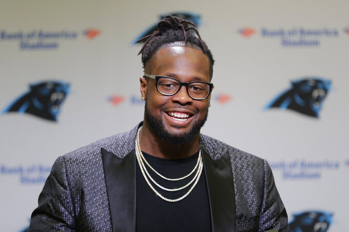Carolina Panthers' Gerald McCoy answers a question during a news conference in Charlotte, N.C., Tuesday, June 4, 2019. After nine productive seasons with the Tampa Bay Buccaneers, the six-time Pro Bowl and three-time All-Pro defensive tackle McCoy signed with the Panthers. (AP Photo/Chuck Burton)