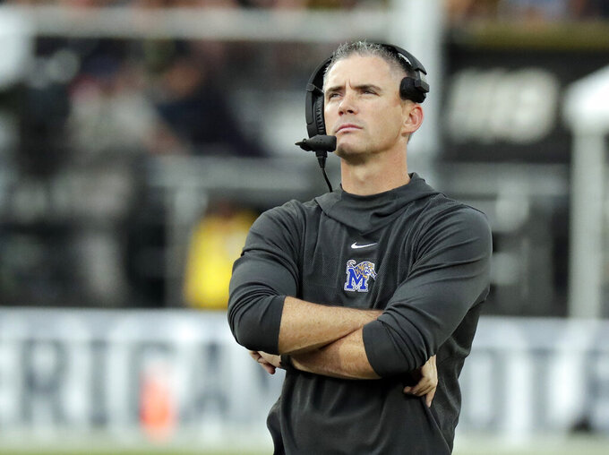 FILE - In this Dec. 1, 2018, file photo, Memphis coach Mike Norvell watches the scoreboard during the American Athletic Conference championship NCAA college football game against Central Florida, in Orlando, Fla. Norvell has produced explosive offenses at Memphis. The Tigers ranked seventh in scoring (42.9) last season and second (45.5) in 2017.  But they haven't been as good on the other side of the ball. Memphis ranked 94th in scoring defense (31.9) last year and 102nd (32.5) in 2017. (AP Photo/John Raoux, File)