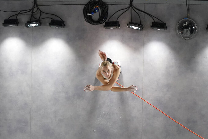 Janja Garnbret, of Slovenia, looks up at the wall prepares to climb during the lead qualification portion of the women's sport climbing competition at the 2020 Summer Olympics, Wednesday, Aug. 4, 2021, in Tokyo, Japan. (AP Photo/Jeff Roberson, POOL)