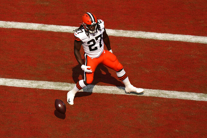 Cleveland Browns running back Kareem Hunt (27) celebrates after scoring a 2-point conversion during the first half of an NFL football game against the Kansas City Chiefs Sunday, Sept. 12, 2021, in Kansas City, Mo. (AP Photo/Charlie Riedel)