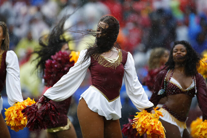 A Washington Redskins cheerleader performs as rain falls in the first half of an NFL football game between the Redskins and the San Francisco 49ers, Sunday, Oct. 20, 2019, in Landover, Md. (AP Photo/Alex Brandon)