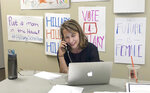 Democratic candidate for Michigan's 3rd congressional district Hillary Scholten calls supporters at her Grand Rapids, Mich. campaign office on Tuesday, July 16, 2019. Scholten is running to replace Michigan Rep. Justin Amash and says she raised $100,000 in the first week since announcing her campaign. Scholten, an attorney from Grand Rapids, joined the race last week, days after Amash said he was leaving the Republican Party and would seek reelection as an independent. Amash had been the only Republican in Congress to call for impeachment proceedings against President Donald Trump. (AP Photo Sarah Burnett)
