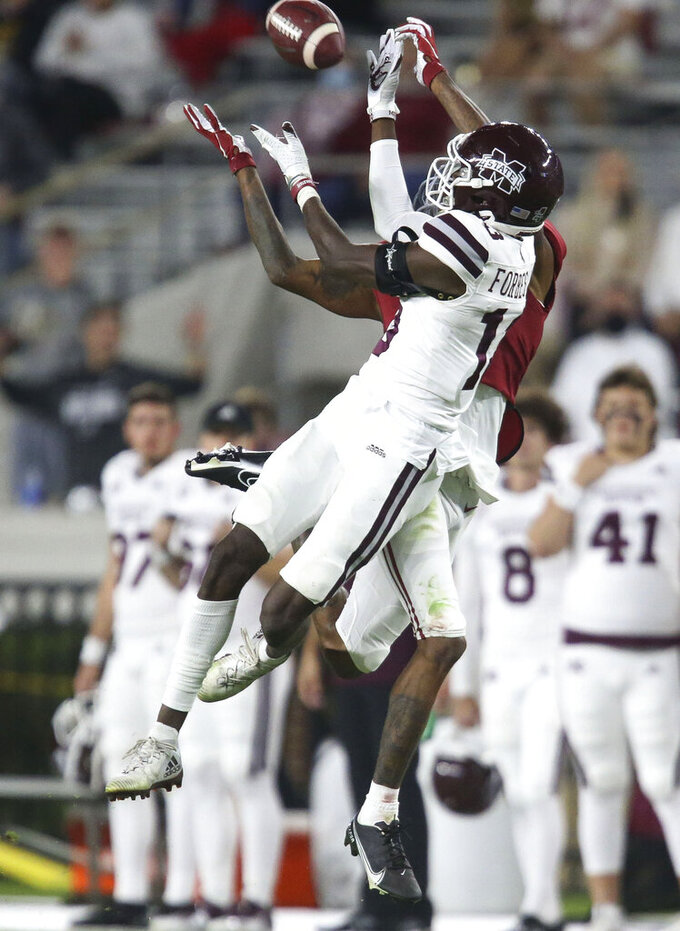 Mississippi State cornerback Emmanuel Forbes (13) breaks up a pass intended for Alabama wide receiver DeVonta Smith during an NCAA college football game Saturday, Oct. 31, 2020, in Tuscaloosa, Ala. (Gary Cosby Jr./The Tuscaloosa News via AP)