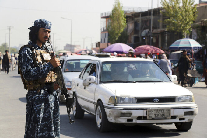 Taliban fighter stand guards in the city of Kabul, Afghanistan, Saturday, Sept. 4, 2021. (AP Photo/Wali Sabawoon)